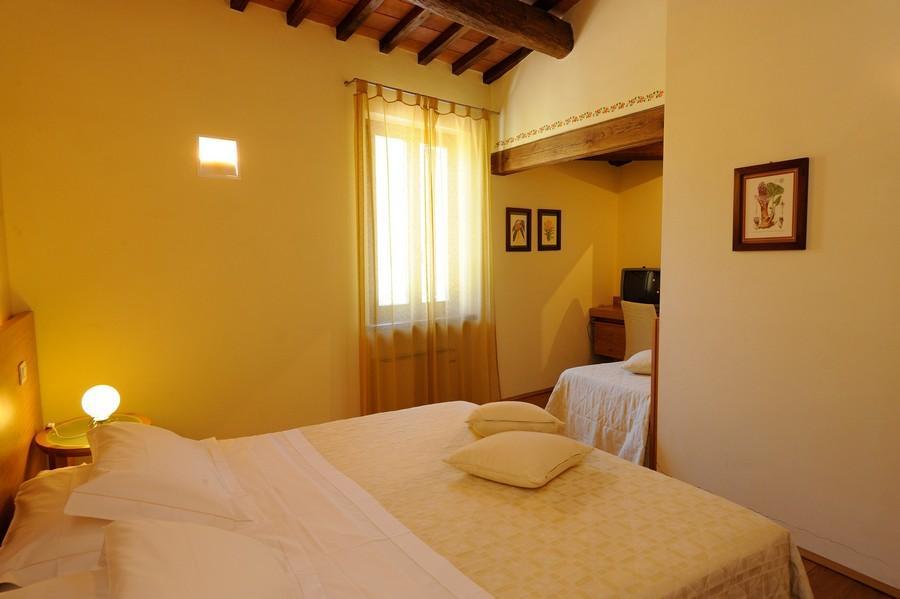 camera da letto con singolo aggiunto nel trilocale